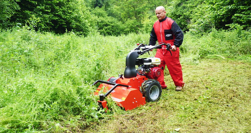 Operator with Ftr750 for cutting grass.