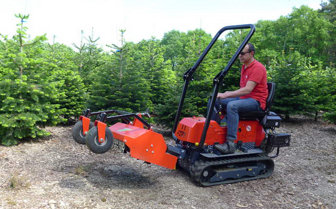 Multifunctional reversible machinery Vision with flail mower.